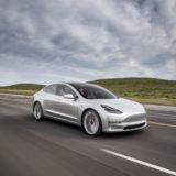 2017-Tesla-Model-3-front-three-quarter-in-motion-02