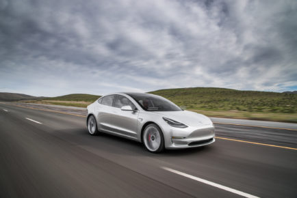 2017-Tesla-Model-3-front-three-quarter-in-motion-02